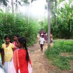 Children arriving at feeding program in Monaragala