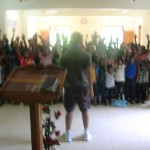 Children praising and worshipping God at feeding program