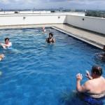 CTFM team relaxing in pool in SL