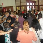 Ministers and Intercessors unite in prayer before meeting