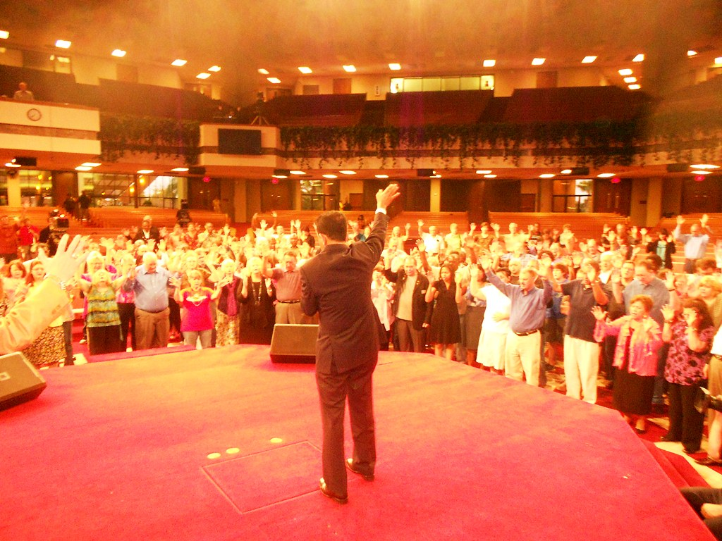 Pr Daniel preaching and leading people in prayer for America