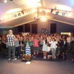 Pr Steve leads people in worship