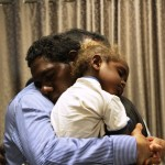 Indigenous man and son ask for a hug