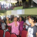 People worshipping at Gospel Tabernacle