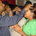 Praying for people at altar at Calvary Church SL