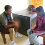 Ps Daniel interviewing another girl at feeding program