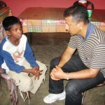 Ps Daniel interviewing a young boy