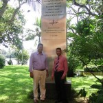 Ps Daniel with Dilma tea company owner's son at tower they erected to honour Jesus
