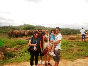 Pr Daniel and family with herd of elephants
