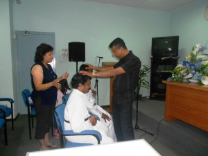 Pr Daniel and Maryse praying for Anglican Ministers